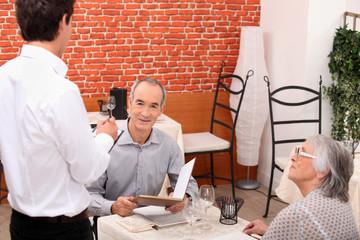 Waiter taking an order