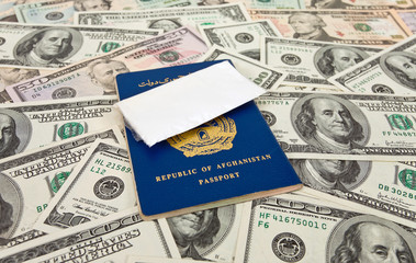 Package with a drug against the Afghan passports and U.S. dollar