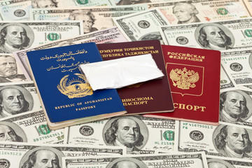 Package with a drug against the passports and U.S. dollars