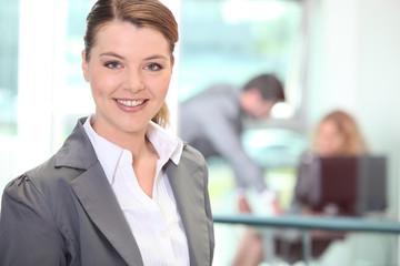 Satisfied employee in gray suit
