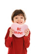 Child with Valentine's Day heart pillow