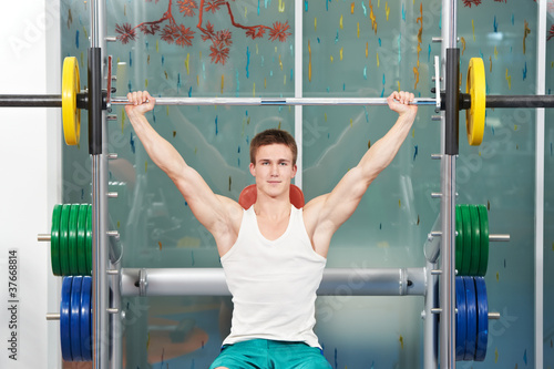bodybuilder man doing muscle exercises with weight