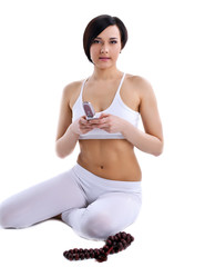 happy woman sit in yoga with beads and phone