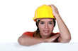 A portrait of a female construction worker.