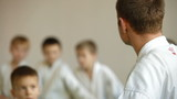 Martial arts instructor training children