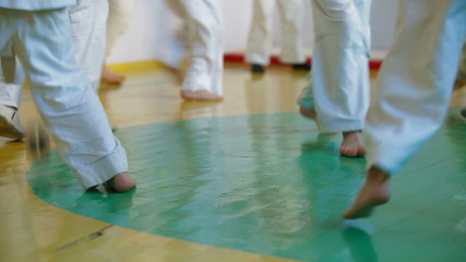 Children practice karate in gym