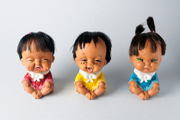 Trio of dolls with different emotions