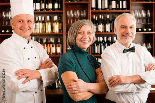 Restaurant manager posing with professional staff