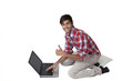 Cute smiling guy on laptop thumbs up