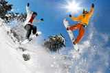 Fototapety Snowboarders jumping against blue sky