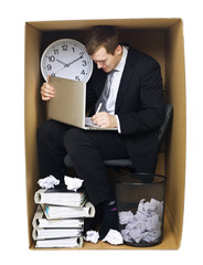 Businessman in a tight office