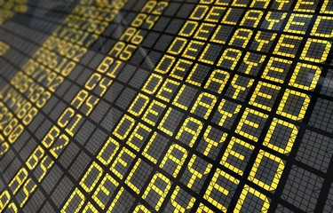 International Airport Board Close-Up with Delayed Flights