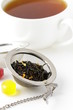 tea strainer with a fragrant black tea and cup