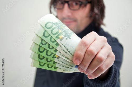 Man paying in euros
