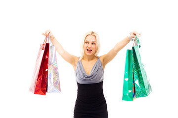 Young beautiful laughing woman with purchases from shop.