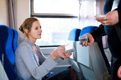 woman having her ticket checked by the conductor