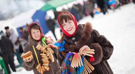 girls celebrating  Pancake Week at Russia