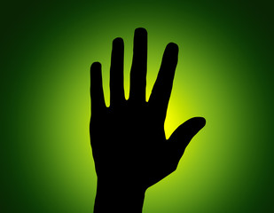 Silhouette Stop Hand on Green Colored Background