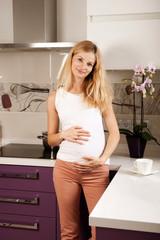 Pregannt woman in kitchen