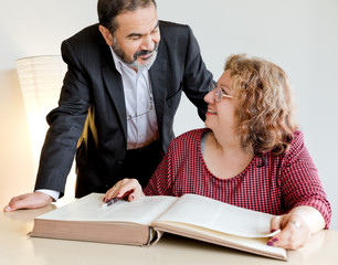 Adult couple behind book
