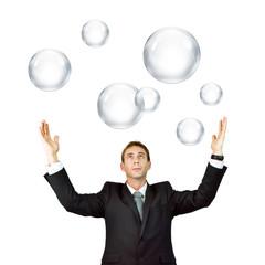 Man catching bubbles