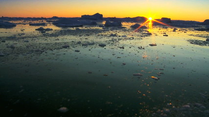 Arctic Sunset over Frozen Landscape