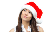 Beautiful woman in christmas santa claus red hat looking up