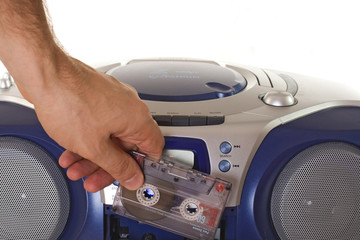 Inserting a cassette into tape recorder