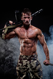 Muscular young sexy naked dirty soldiers with knife