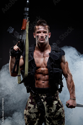 Muscular young sexy naked soldiers with knife
