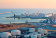 Leinwandbild Motiv LNG Tanks at the Port of Barcelona at Sunset