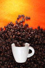Coffee cup with beans on orange background