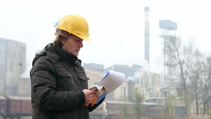 Engineer with Hard Helmet and Clipboard