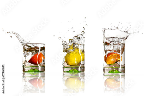 Drinks with splashing citrus fruits over white - 37706053