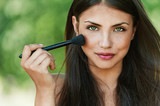 Girl with brush for makeup