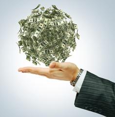 Money on a businessman's hand