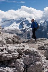Male hiker in front of Mt. Marmolada