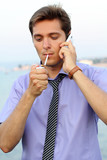 Young businessman with telephone,handsome man smoking cigarette,