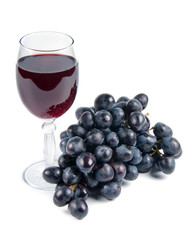 glass with wine and grapes