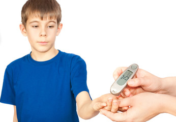 The boy is doing a test for diabetes