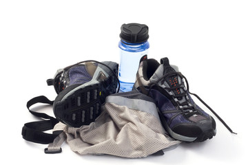 sneakers with water bottle and reflective vest