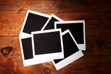 Photo paper on wooden background