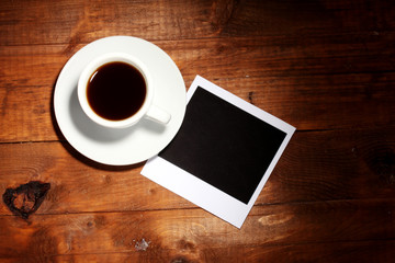 Photo paper with coffee on wooden background