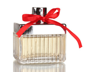 Perfume bottle with red bow isolated on white