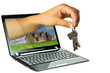 Black netbook with 3D hand giving keys to new house