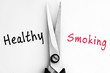 Healthy and Smoking words with scissors in middle