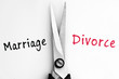 Marriage and Divorce words with scissors in middle