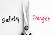 Safety and Danger words with scissors in middle