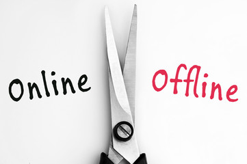 Online and Offline words with scissors in middle