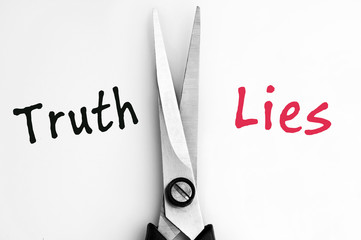 Truth and Lies words with scissors in middle